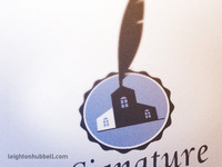 Ink and quill real estate logo