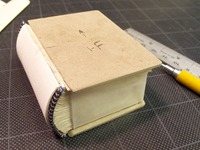 Miniature book with boards