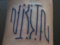 Nikita Ambigram Tattoo